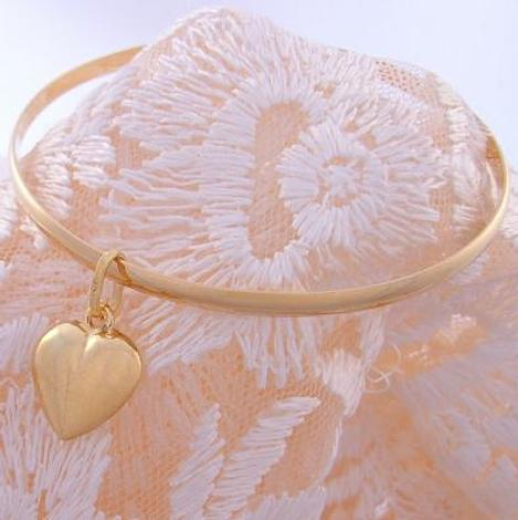 9CT SOLID GOLD BANGLE WITH FLOATING HEART CHARM